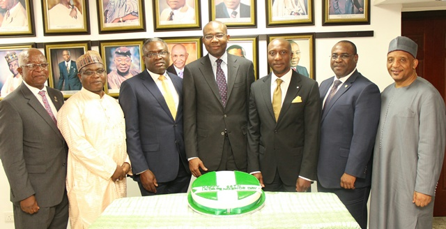 L – R: Mr. Oladipo Aina, Member, National Council, The Nigerian Stock Exchange (NSE); Alhaji Umoru Kwairanga, Member, National Council, NSE; Mr. Oluwole Abegunde, Member, National Council, NSE; Mr. Aigboje Aig-Imoukhuede, CON, President, National Council, NSE; Mr. Oscar N. Onyema, OON, Chief Executive Officer, NSE and Mr. Dunama Balami, Member, National Council, NSE, celebrating Nigeria at 55