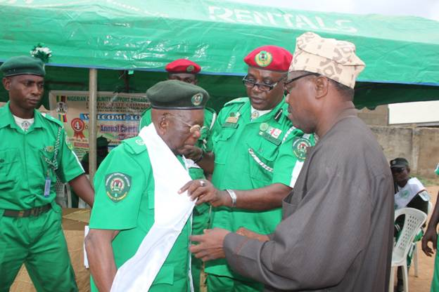 Lagos State Commander, Senior Comrade Gabriel Adeoye, and, Deputy Director Programmes, National Orientation Agency (NOA), Mr Raphael Bowoto, decorating the Royal Father Of the Day, HRH Cyril Mosuala Anomeze as Executive Chief Camp Mayor, while Eze's PA looks on