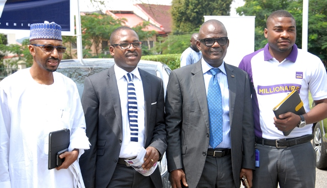 L-R: Mr. Ibrahim Boyi, Managing Director/Chief Executive of Peugeot Automobile Nigeria (PAN) Limited; Mr. Olajire Awofisibe, Head, Retail Assets of First City Monument Bank (FCMB) Limited; Mr. Sunday Egele, Retail Head, Abuja & North Region of the Bank, and Mr. Hassan Ninalowo, Product Manager, Auto Loans of the Bank, during the launch of the FCMB/PAN Auto Loan Alliance Scheme on Thursday in Abuja