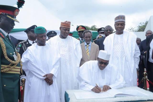 Nigeria@55_newsverge.com-buhari-sign