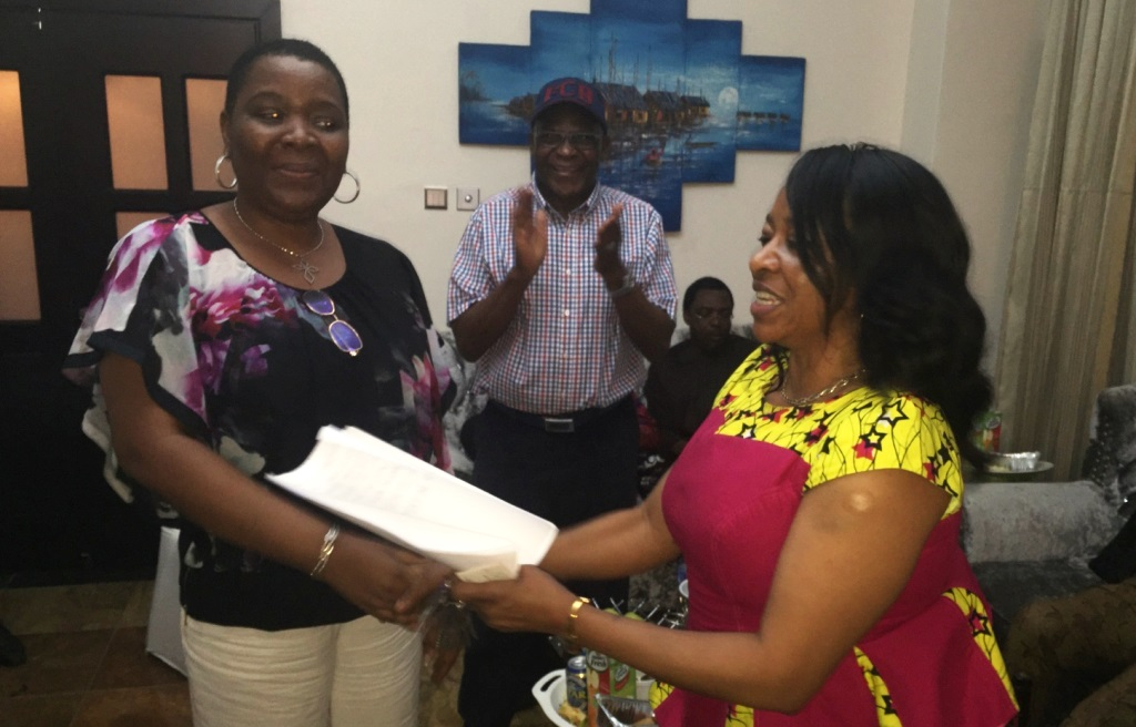 Outgoing President of the Lagos Business School AMP 12, Chief (Mrs.) Victoria Ekhomu (right), presenting her hand-over notes to the incoming president, Nkechi Obi (left) at the meeting and get together party/election for the group...recently