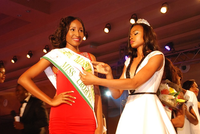 Ex-Miss Nigeria 2014, Ezinne Akudo Decorating The Winner  of Miss Nigeria 2015, Pamela Peter-Vigboro Leesi