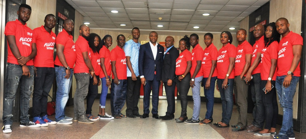 Head, Marketing and Brand Communication, UBA Plc, Mr. Ikemefuna Mordi; Directorate Head, Public Sector Group, Mr. Oliver Alawuba; Head, Strategy and Products, Mr. Idukpaye Iyke and winners of the UBA Remittance AWOOF Promo, before departure to Dubai, at a ceremony held  in Lagos during the weekend