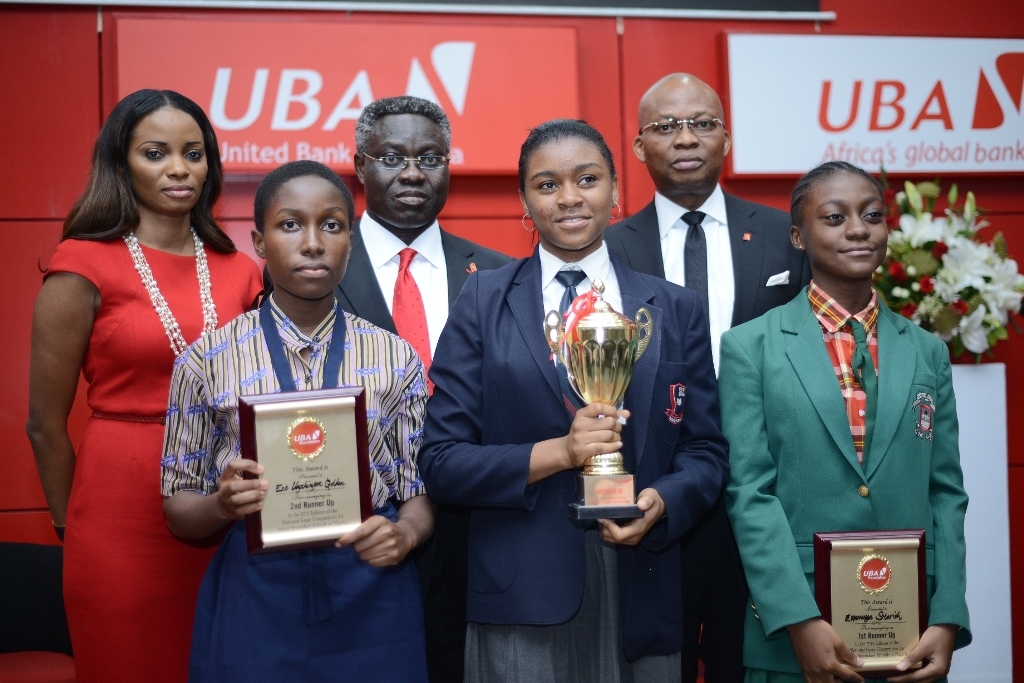 Managing Director, UBA Foundation, Ms. Ijeoma Aso, GMD/CEO, UBA Plc, Mr. Phillips Oduoza and DMD, UBA Plc, Mr. Kennedy Uzoka with the winners of 2015 UBA Foundation National Essay Competition- 1st prize winner Miss Emediong Uduak Uko of British Nigerian Academy, Abuja (middle) ;  2nd prize winner Miss Enonuoya Starish of Lagoon School Lagos (right); and 3rd prize winner Miss Eze Ugochinyere Golden of Living World Academy Aba, during the grand finale and prize giving ceremony held at UBA House in Lagos on Monday