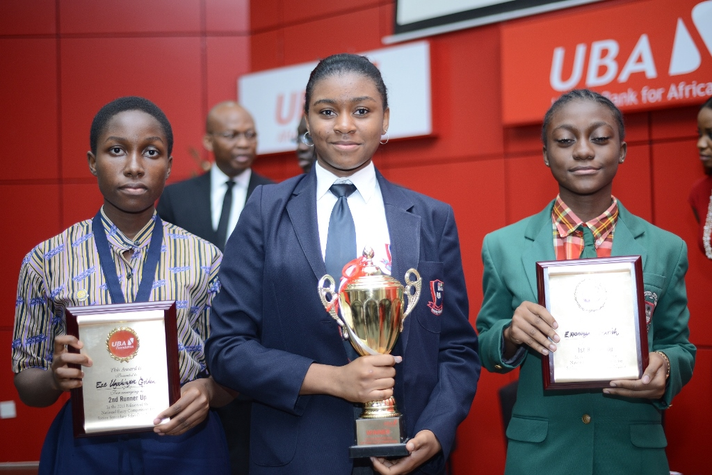 L-R: Overall Winner of the UBA Foundation National Essay Competition for secondary schools, Miss Emediong Uduak Uko of British Nigerian Academy, Abuja (middle) flanked by 2nd prize winner Miss Enonuoya Starish of Lagoon School Lagos (right) and 3rd prize winner Miss Eze Ugochinyere Golden of Living World Academy Aba, during the Grand finale and prize giving ceremony held at UBA House in Lagos on Monday.
