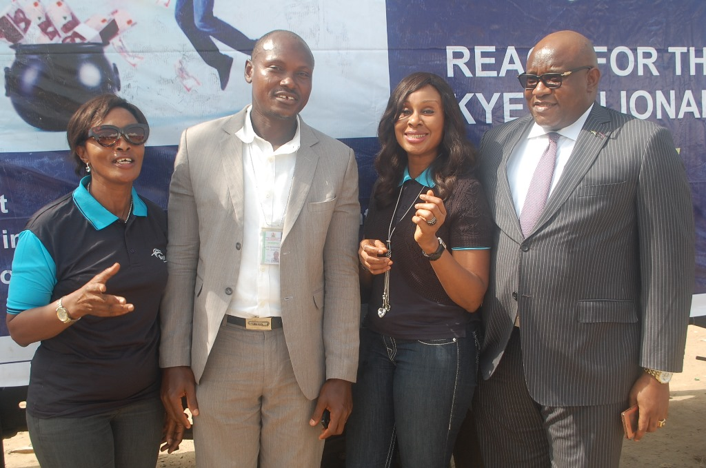 "L-R: Area Manager, Greater Lagos 2, Skye Bank Plc., Adejumoke Odutola, Assistant Manager, National Lottery Regulatory Commission, Lagos 2, Horace Abolo, Head, Retail Banking, Skye Bank Plc., Nkolika Okoli and Regional Director, Ikeja, Skye Bank Plc., Ndubuisi Osakwe at the Bank's ""Reach For The Skye"" reward draw held in Better Life Main Market , Ikorodu area of Lagos on Thursday"