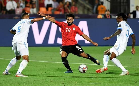 Salah sets up Egypt win over Uganda who still reach last 16